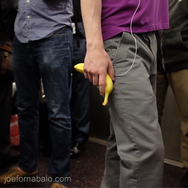 Don't leave home without it. Stay plugged in. Morning commute. #morningcommute #subway #joefornabaio #nyc #train #mta #fruit #banana