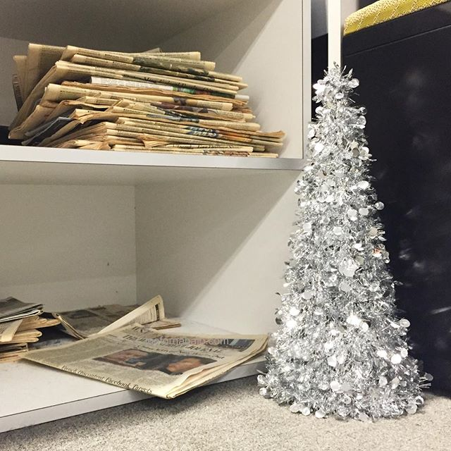 Another one in the office.#christmastree #work #joefornabaio #nyc #spring #newspaper #printisnotdead #tinsel